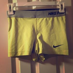 Yellow Nike pro spandex